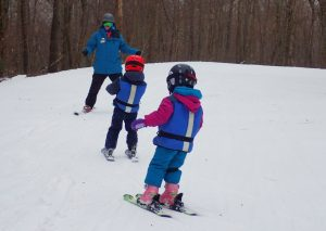 Snow Sport University Ski Instructor Ira Tillberg with his class on Meadowlark
