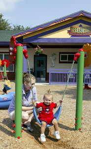 Toddlers on a swing at TREASURES child care