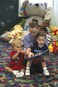 Children being read to at TREASURES child care.
