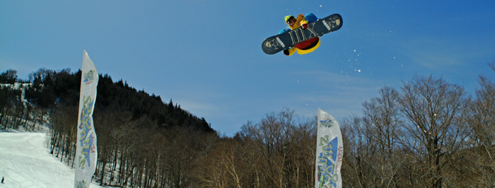Snowboarder getting air in the Zone.
